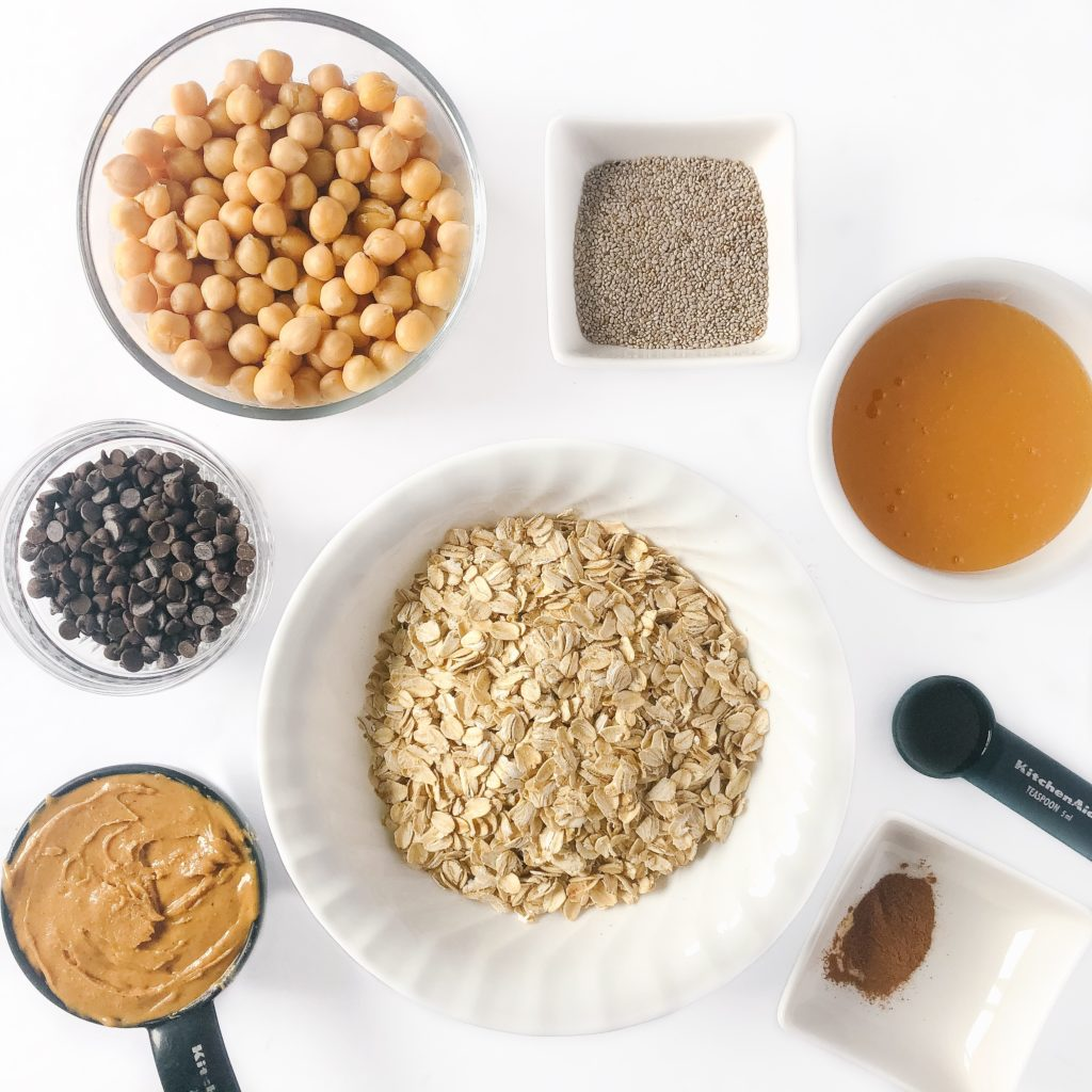 ingredients displayed - peanut butter, oats, chocolate chips, chickpeas, chia seeds, honey, cinnamon, vanilla extract