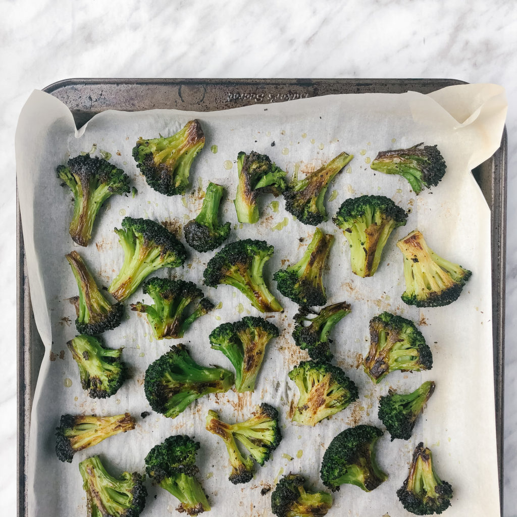 Crispy roasted frozen broccoli on a sheet pan