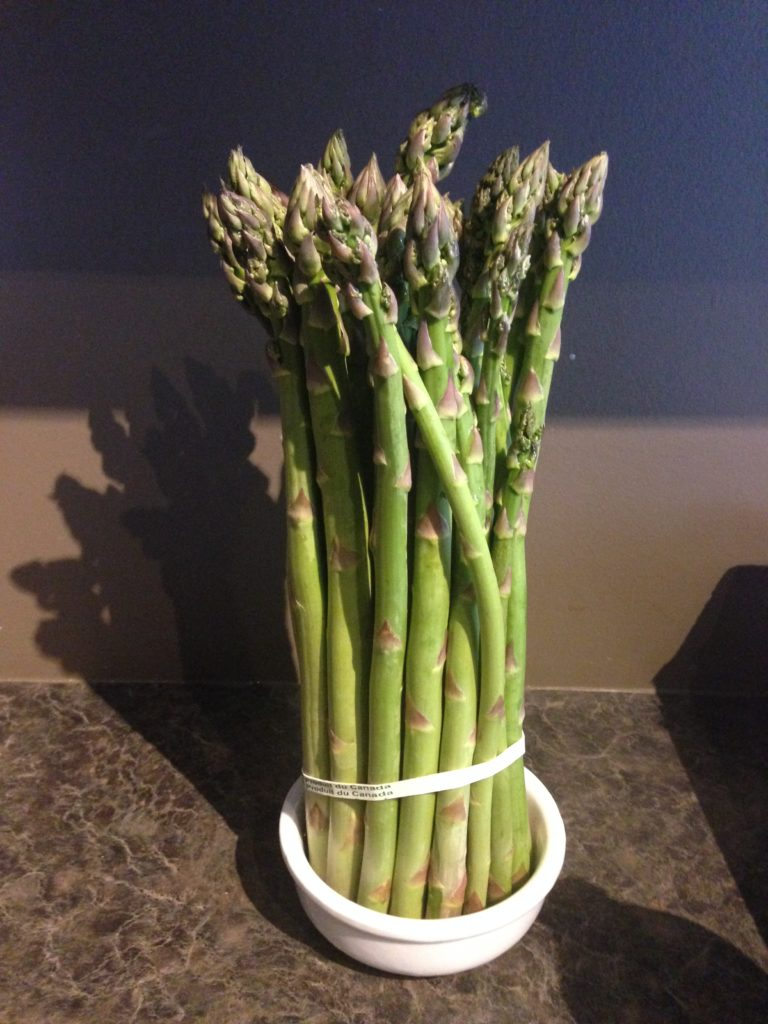 asparagus standing in water