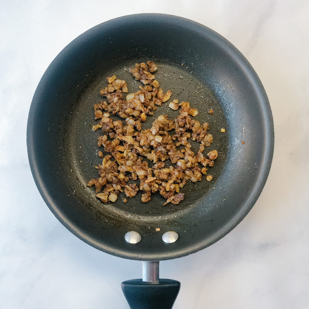 Caramelized onions in a pan with spices
