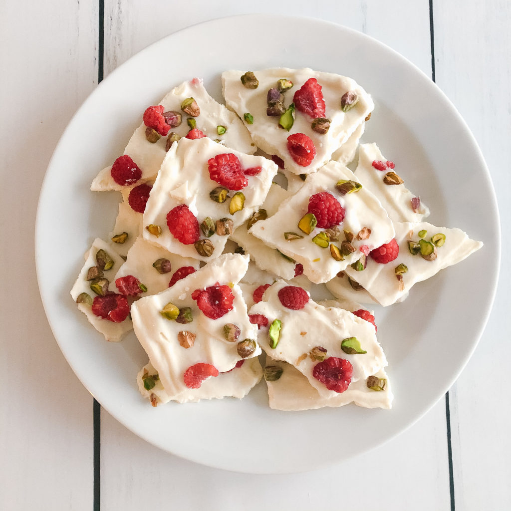 Festive raspberry pistachio vanilla frozen greek yogurt bark
