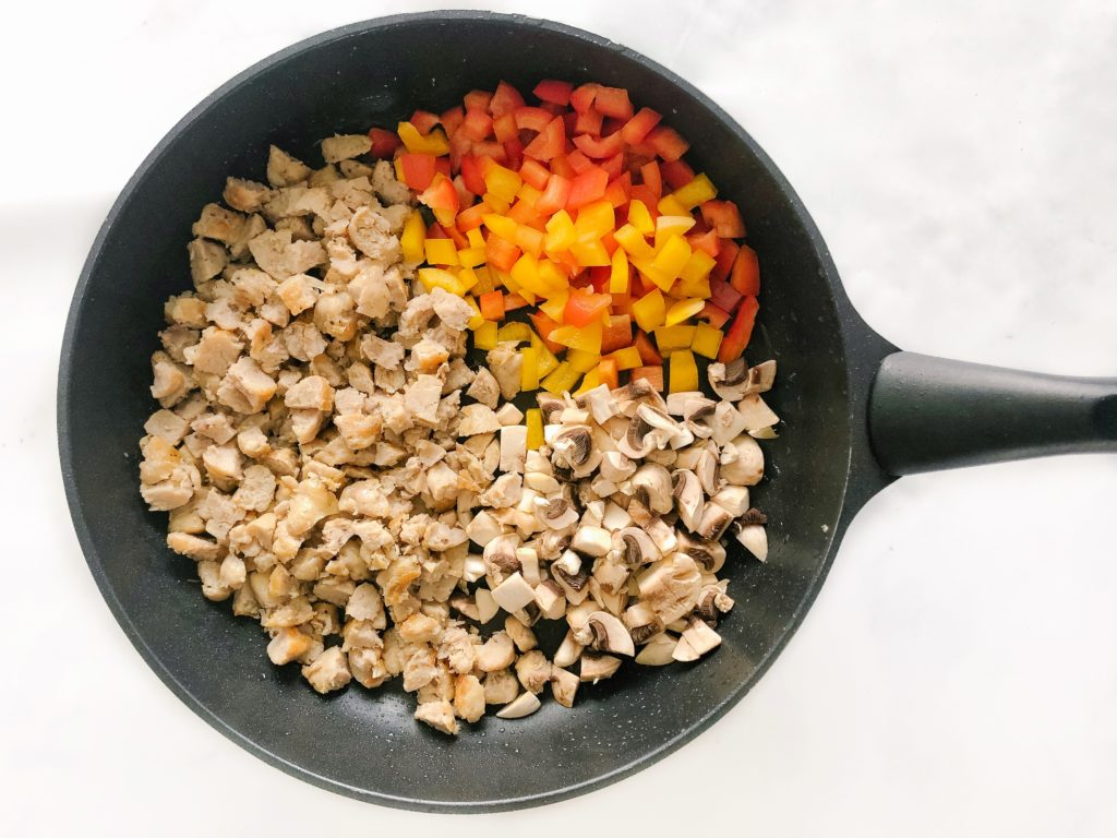 chicken sausage, peppers, mushrooms in a pan