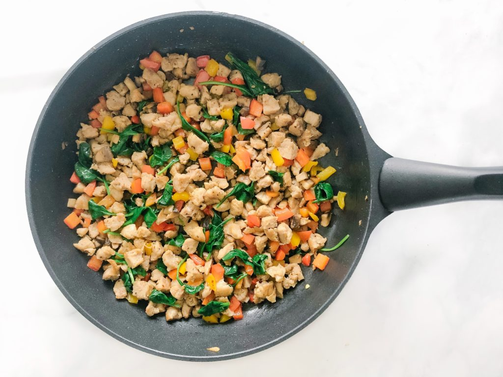 cooked chicken sausage, bell pepper, mushrooms, spinach in a pan