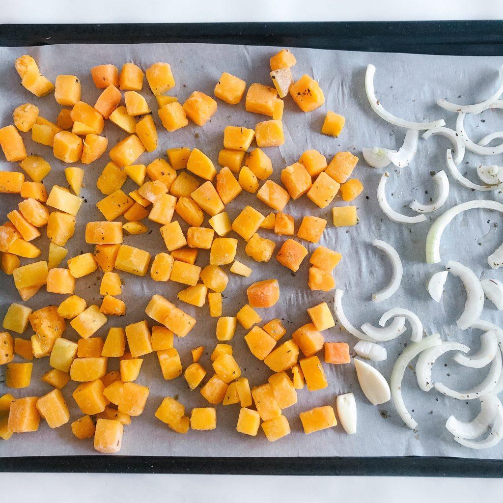 Butternut squash, onion and garlic on a sheet pan