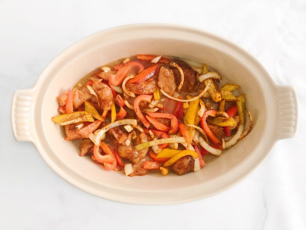 fajita casserole ingredients in a pan before baking